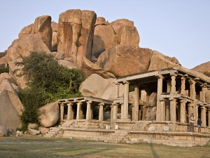Giant boulders loom over a Hampi temple.
