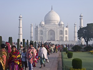 People crowd in to visit the Taj Mahal.